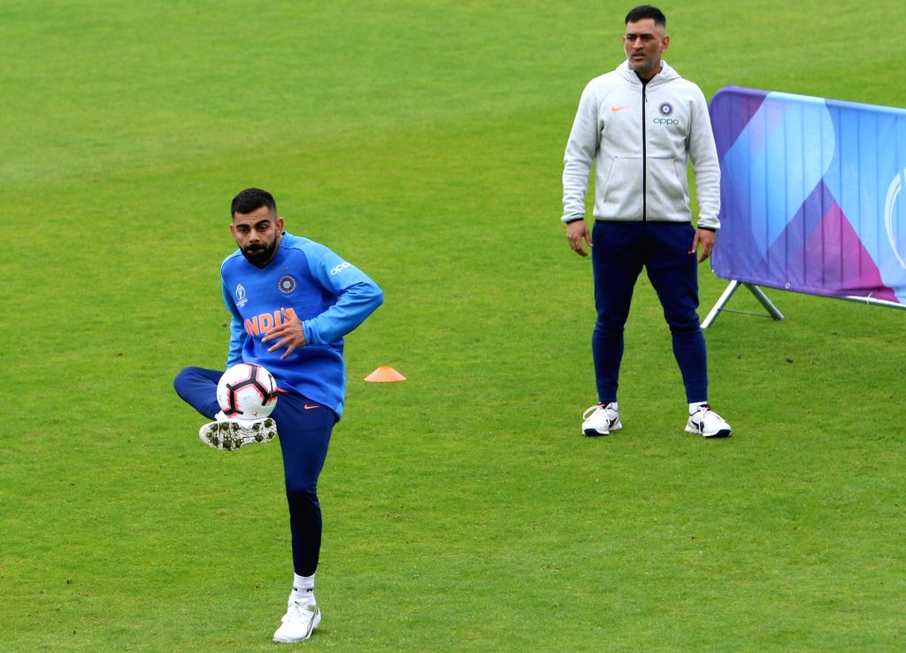 Southampton: India's Virat Kohli and M.S. Dhoni during a practice session ahead of a World Cup 2019 match against Afghanistan at the Hampshire Bowl in Southampton, England on June 19, 2019. (Photo: Surjeet Yadav/IANS) - Virat Kohli and Surjeet Yadav