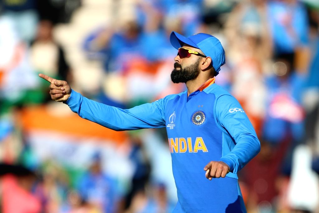 Southampton: India's Virat Kohli celebrates after winning the 28th match of World Cup 2019 against Afghanistan by 11 runs at The Rose Bowl in Southampton, England on June 22, 2019. (Photo: Surjeet Yadav/IANS) - Virat Kohli and Surjeet Yadav
