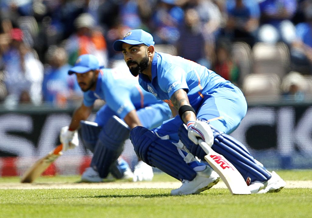 Southampton: India's Virat Kohli in action during the 28th match of World Cup 2019 between India and Afghanistan at The Rose Bowl in Southampton, England on June 22, 2019. (Photo: Surjeet Yadav/IANS) - Virat Kohli and Surjeet Yadav