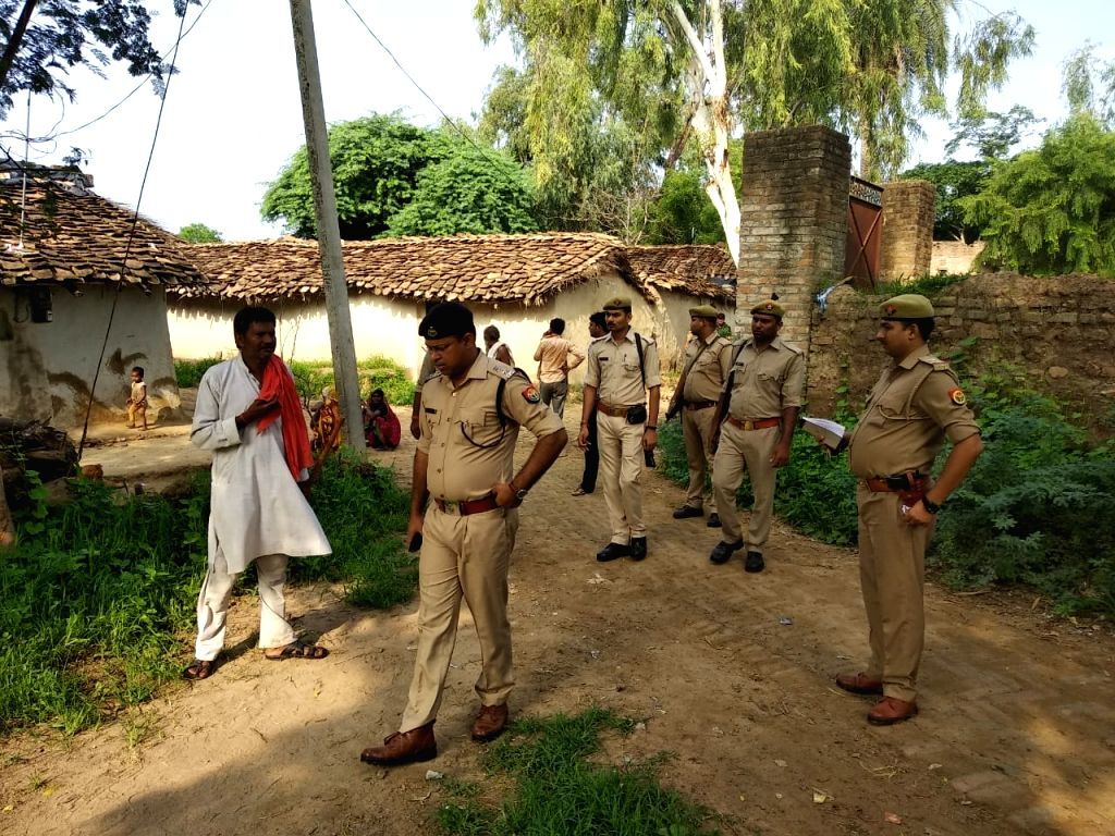 SP Ganesh Saha inspecting the scene after an OLA driver was killed in Aliha village of Banda.