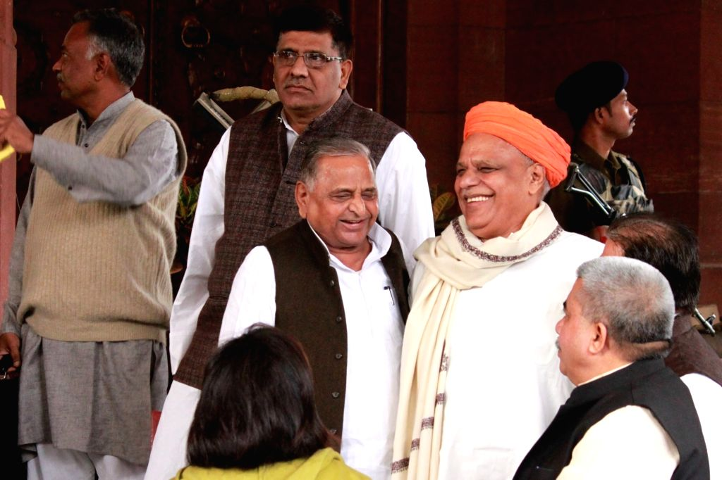 SP supremo Mulayam Singh and BJP MP Virendra Singh Mast at the Parliament in New Delhi, on Dec 10, 2015. - Mulayam Singh and Virendra Singh Mast