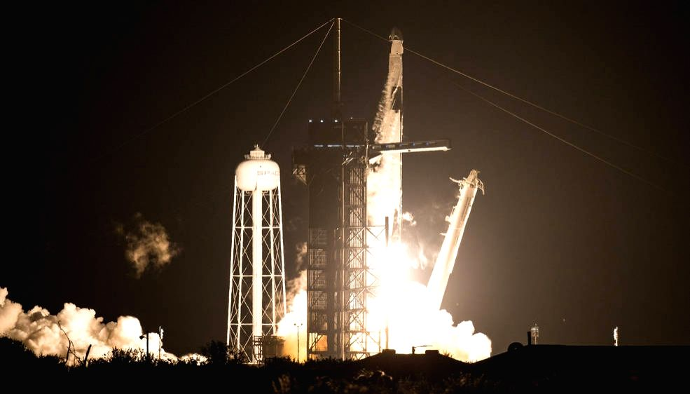 SpaceX rocket launches 4 astronauts to space station.