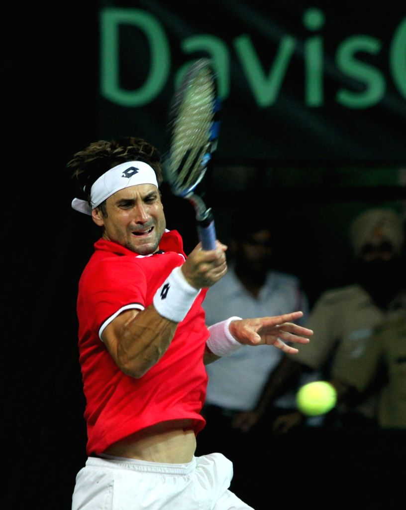 Spain's David Ferrer in action against India's Ramkumar Ramanathan during Davis Cup World Group Play-off match at RK Khanna Tennis Stadium in New Delhi on Sept 18, 2016. Spain won.