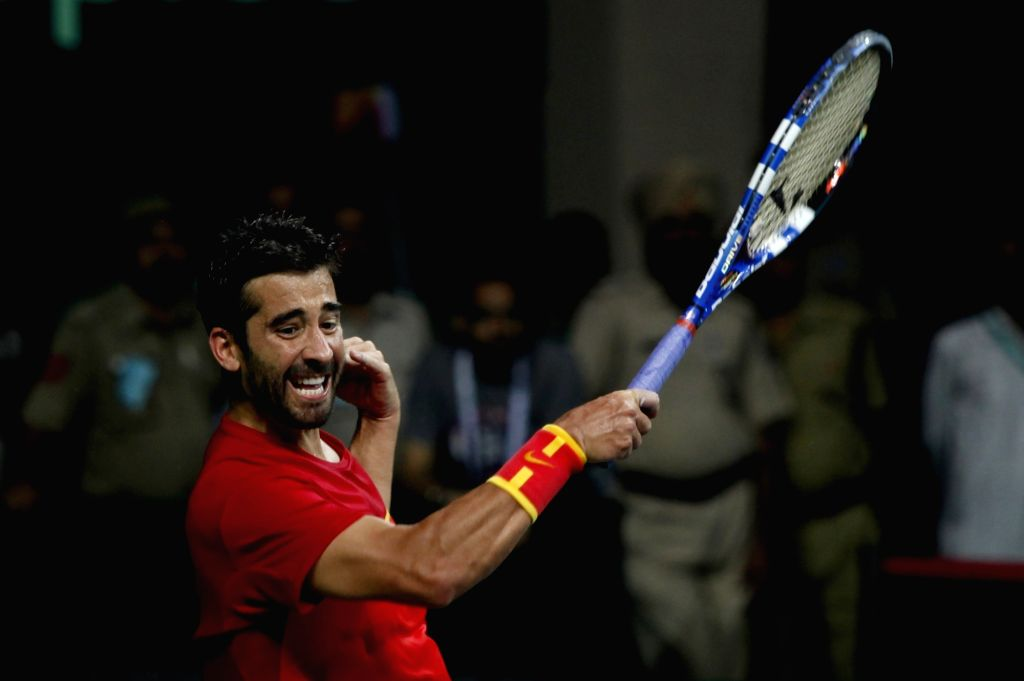 Spain's Marc Lopez in action against India's Sumit Nagal during Davis Cup World Group Play-off match at RK Khanna Tennis Stadium in New Delhi on Sept 18, 2016. Spain won.