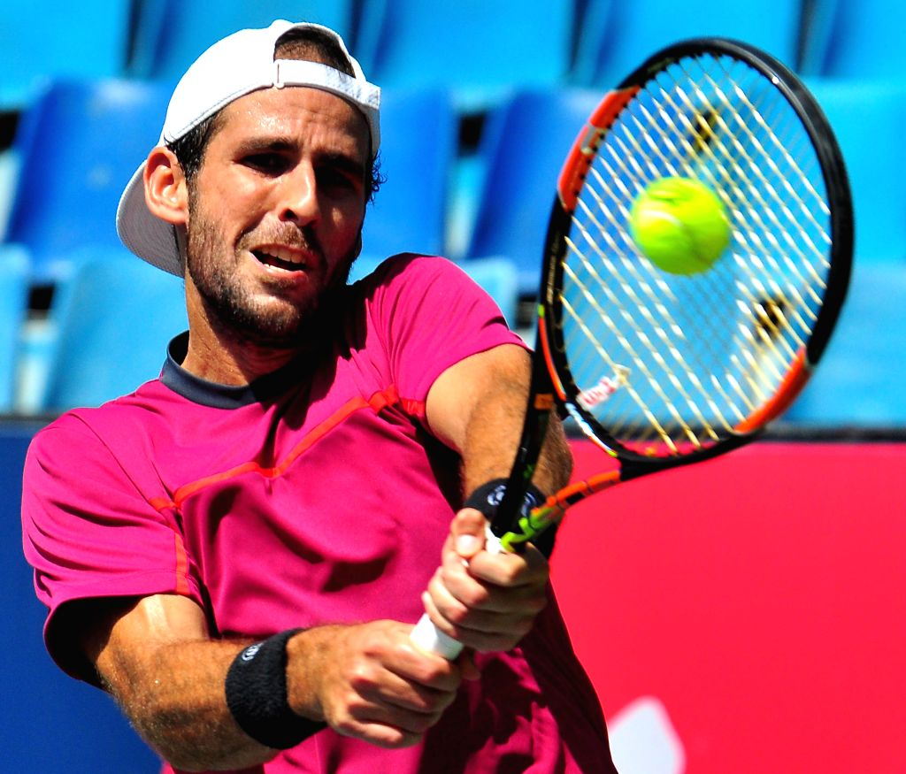 Spanish tennis player Adrian Menendez-Maceiras in action against Saketh Myneni of India during ATP Challenger Tour at KSLTA, in Bengaluru, on Oct 24, 2015.