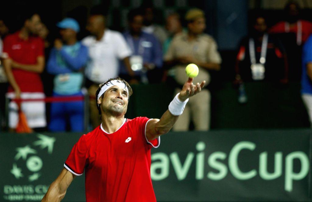 Spanish tennis player David Ferrer in action against India's Saketh Myneni during Davis Cup World Group Play-off at RK Khanna Tennis Stadium in New Delhi on Sept 16, 2016. David Ferrer won.