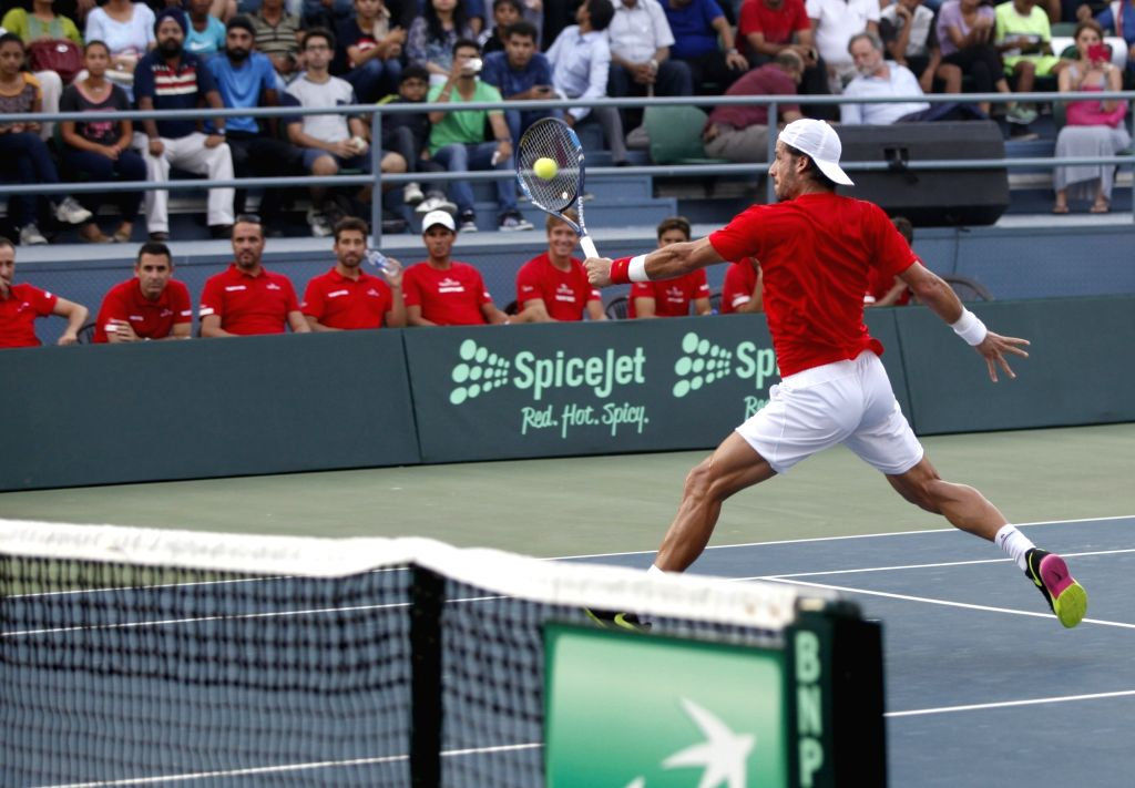 Spanish tennis player Feliciano Lopez in action against India's Ramkumar Ramanathan during Davis Cup World Group playoff match between Indian and Spain at the Delhi Lawn Tennis Association ...