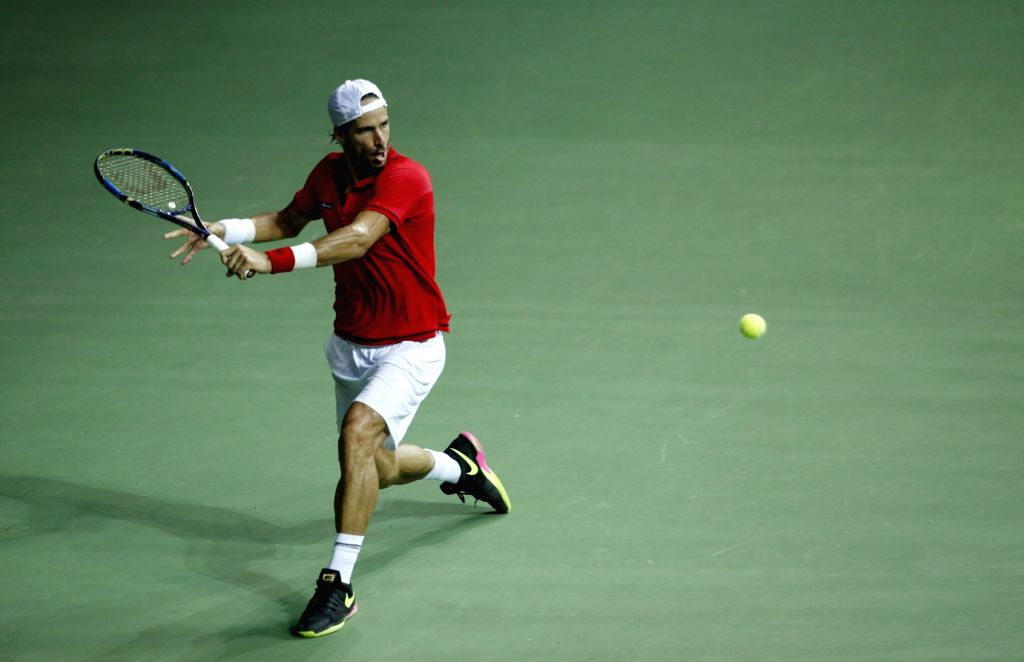 Spanish tennis player Feliciano Lopez in action against India's Ramkumar Ramanathan during Davis Cup World Group Play-off at RK Khanna Tennis Stadium in New Delhi on Sept 16, 2016. ...