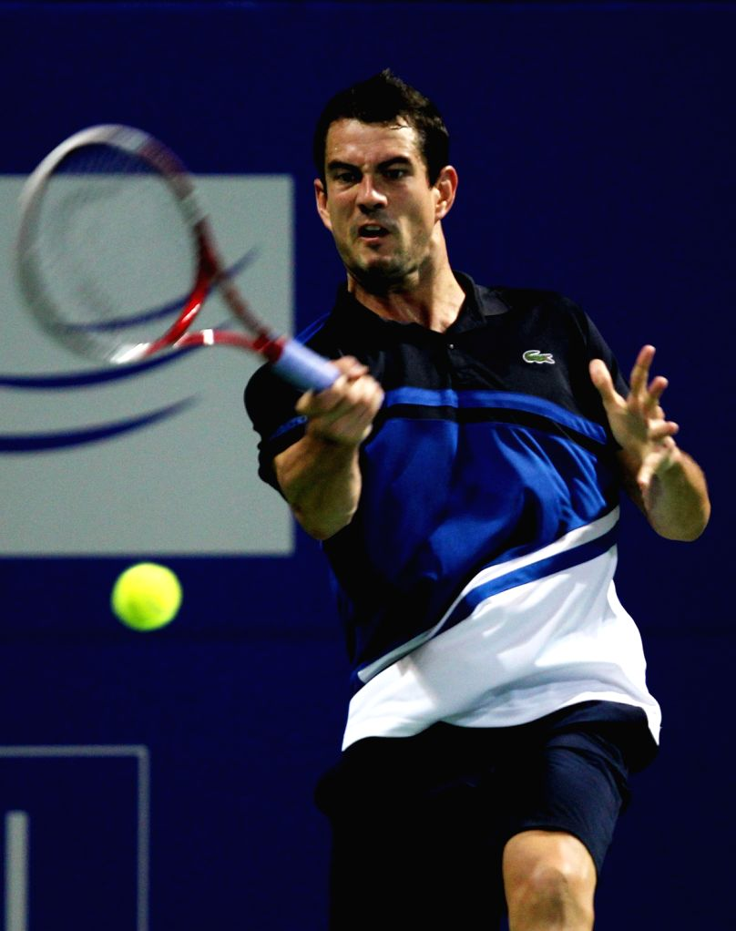 Spanish Tennis player Guillermo Garcia-Lopez in action against Benoit Paire of France during the second round of men's singles for ATP Chennai Open 2014 in Chennai on Jan.2, 2014.