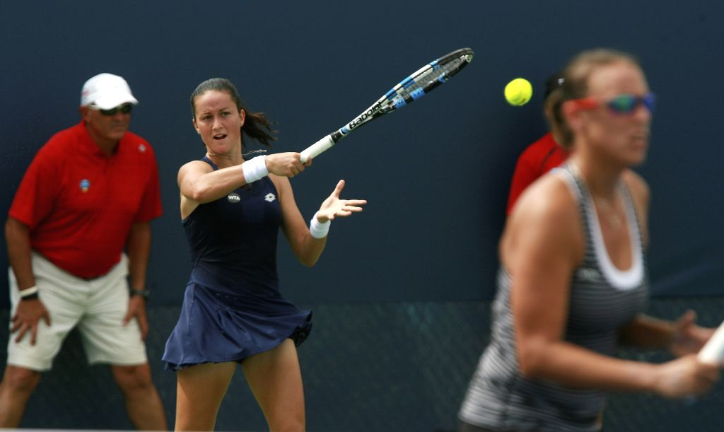 Spanish tennis player Lara Arruabarrena (L) returns the ball next to her teammate Slovak Andreja Klepac (R), against Italians Sara Errani and Flavia Pennatta during the first round of the doubles ...