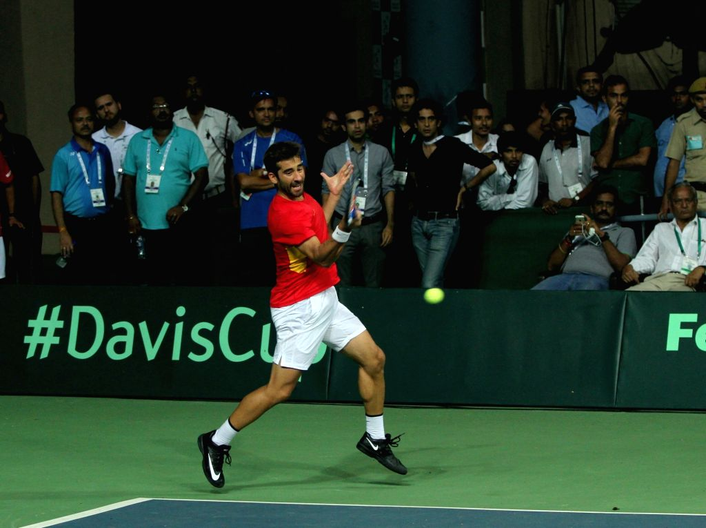 Spanish tennis player Marc Lopez in action during Davis Cup World Group Play-off doubles match against India's Leander Paes and Saketh Myneni at RK Khanna Tennis Stadium in New Delhi on ...