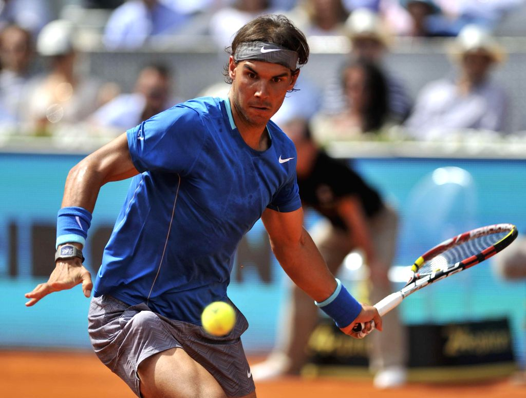 Spanish tennis player Rafael Nadal in action against his Finnish counterpart Jarkko Nieminen during the third round match of the Madrid ATP Tennis Open Singles in Madrid, Spain on May 8, 2014. Nadal .