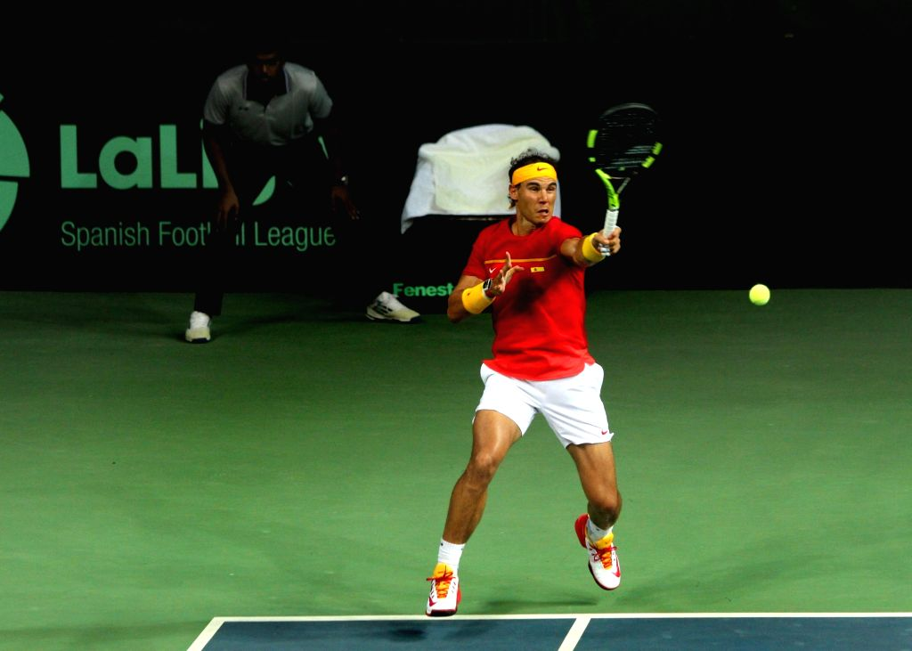 Spanish tennis player Rafael Nadal in action during Davis Cup World Group Play-off doubles match against India's Leander Paes and Saketh Myneni at RK Khanna Tennis Stadium in New Delhi on ...