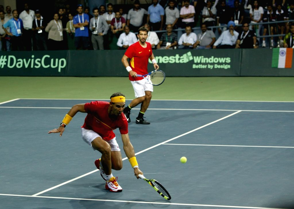Spanish tennis players Rafael Nadal and Marc Lopez in action during Davis Cup World Group Play-off doubles match against India's Leander Paes and Saketh Myneni at RK Khanna Tennis Stadium ...