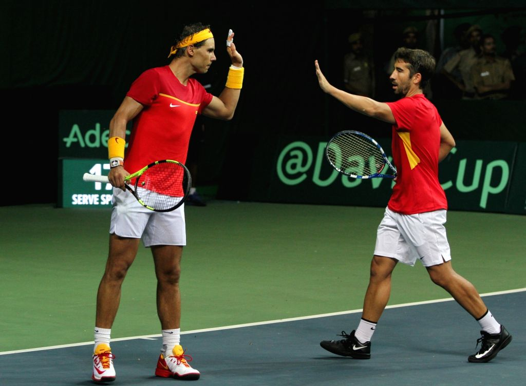 Spanish tennis players Rafael Nadal and Marc Lopez celebrate after winning Davis Cup World Group Play-off doubles match against India's Leander Paes and Saketh Myneni at RK Khanna Tennis ...