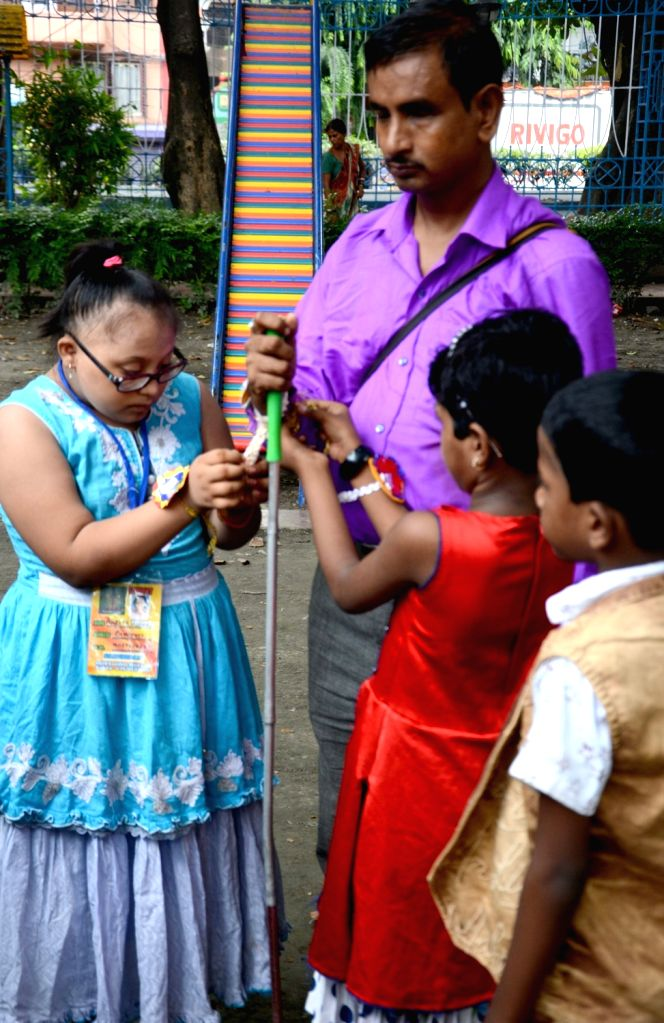 Special children celebrate Raksha Bandhan in Kolkata on Aug 12, 2019.