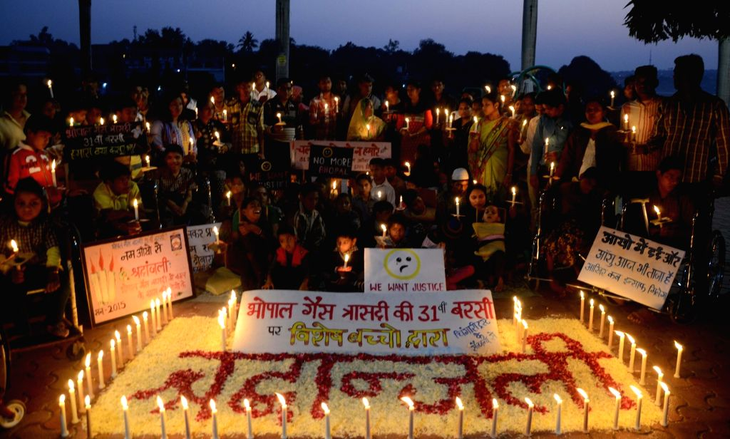 Special children pay tribute to the victims of Bhopal gas tragedy on its 31st anniversary in Bhopal, on Dec 1, 2015.