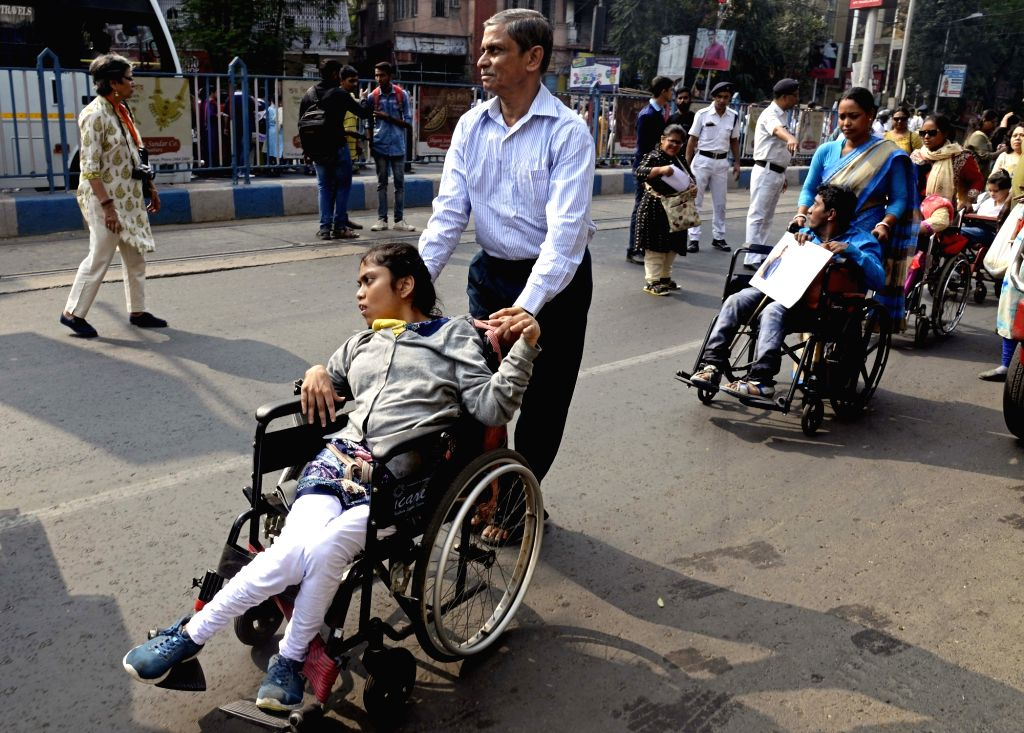 Specially able persons participate in a rally, organised on the occasion of International Day of Disabled Persons, demanding their inclusion in Census 2021, in Kolkata on Dec 3, 2019.