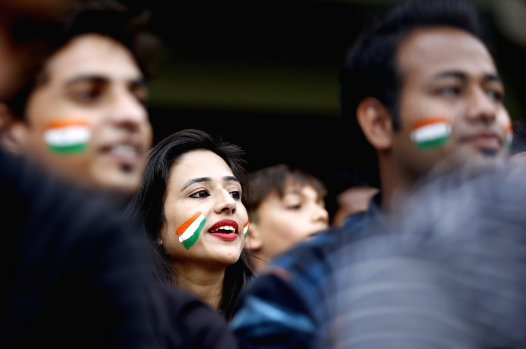 Spectators cheer on the second day of the third test match between India and New Zealand at Holkar stadium in Indore on Oct 9, 2016.