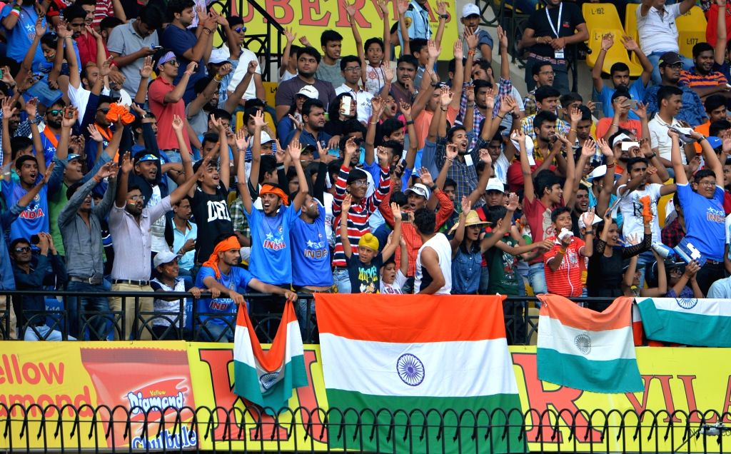 Spectators cheer on the second day of the third test match  between India and NewZealand at Holkar stadium in Indore on Oct 9, 2016.