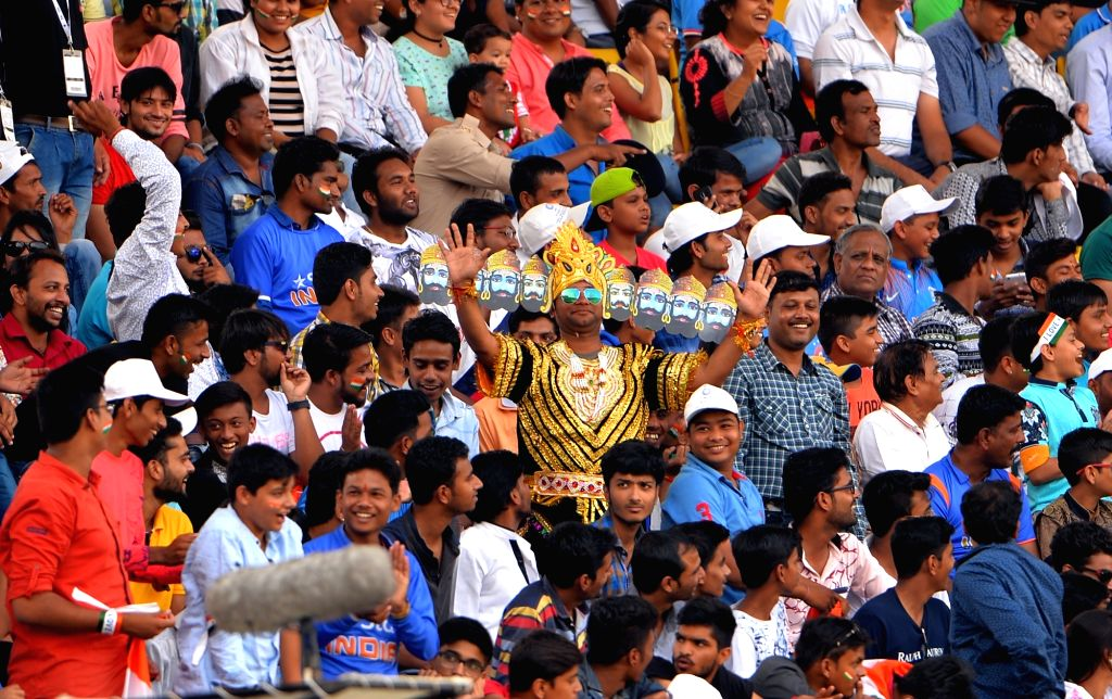 Spectators cheer on the third day of the third test match between India and New Zealand at Holkar stadium in Indore on Oct 10, 2016.