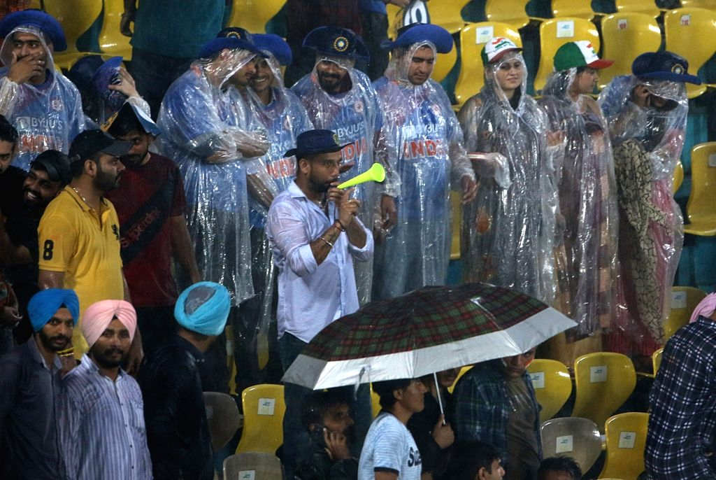 Spectators shield themselves with umbrellas during rains ahead of the first T20I match between India and South Africa in Dharamsala on Sep 15, 2019.