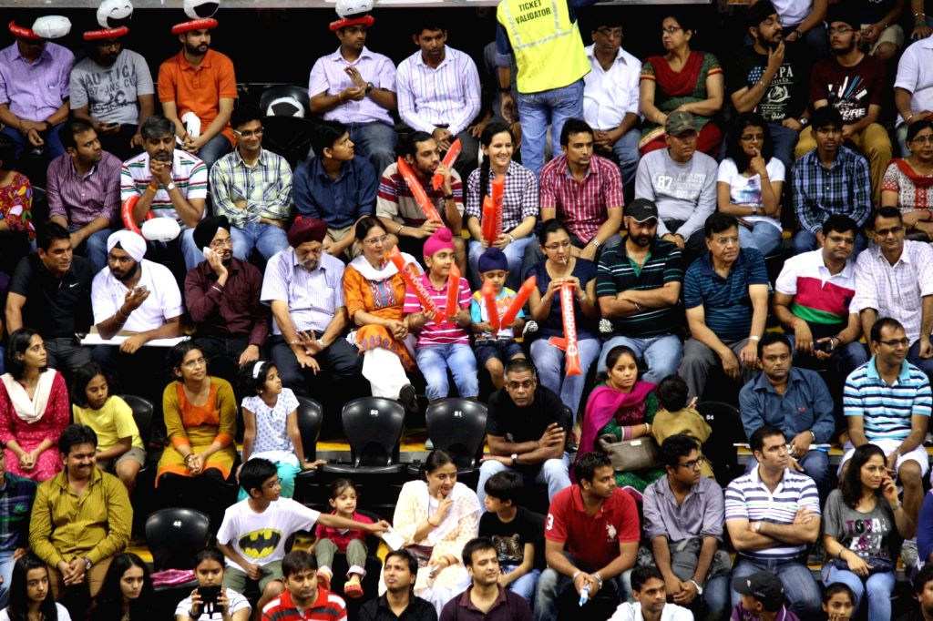 Spectetors watch the match between Saina Nehwal of Hyderabad Hotshots and PV Sindhu of Awadhe Warriors at the Indian Badminton League in New Delhi on August 13, 2013. (Photo::: IANS)