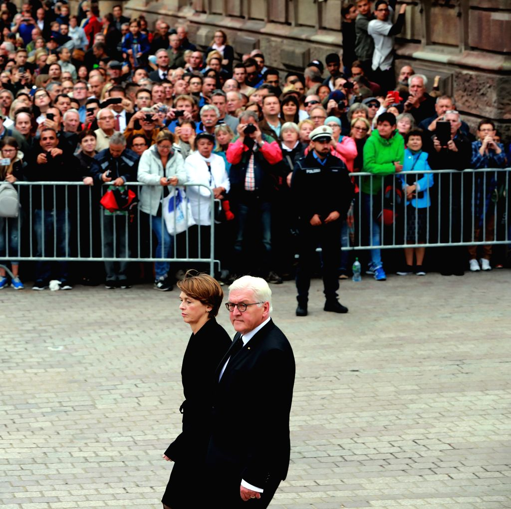 SPEYER, July 2, 2017 - German President Frank-Walter Steinmeier (Front) and his wife Elke Buedenbender arrive for a requiem mass for late Chancellor Helmut Kohl in the Speyer Cathedral in Speyer, ...