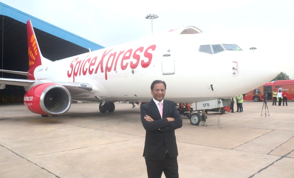 SpiceJet Chairman and Managing Director Ajay Singh with the newly launched first freighter aircraft of SpiceJet, in New Delhi on Sept 10, 2018. - Ajay Singh