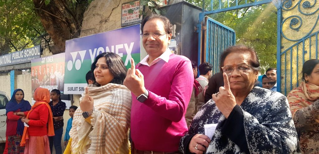 SpiceJet Chairman and MD and Boxing Federation of India (BF) President Ajay Singh along with his family members, shows his inked finger after casting his vote for the Delhi Assembly ... - Ajay Singh