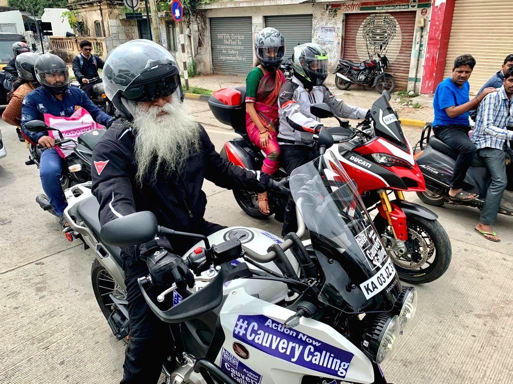 Spiritual guru Sadhguru Jaggi Vasudev rides a motorbike along with 25 other riders during a rally under 'Cauvery Calling' at Talacauvery in Karnataka on Sep 3, 2019. The rally starts ...