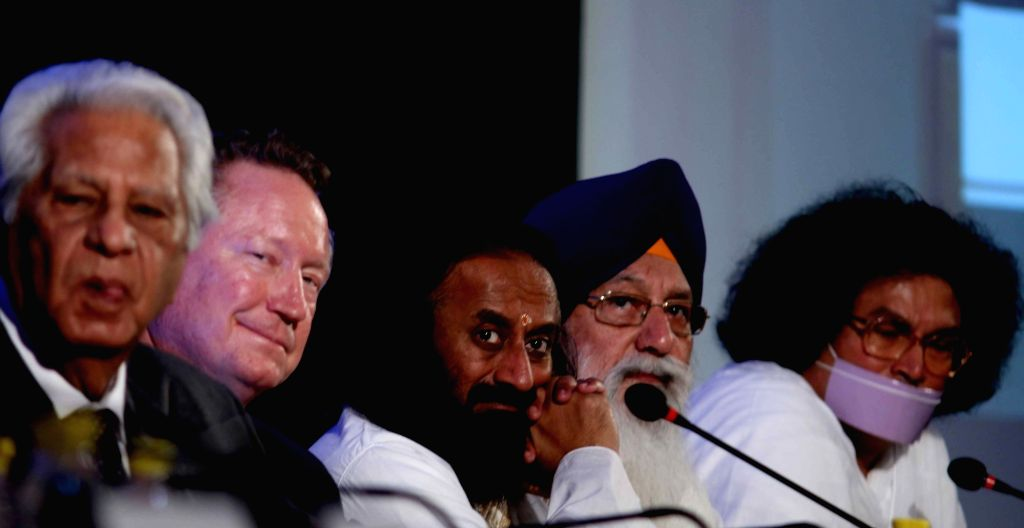"Spiritual leader Sri Sri Ravi Shankar and others during "" Joint Declaration Against Modern Slavery"" - a programme organised by Global Freedom Network in New Delhi, on Dec 3, ..."