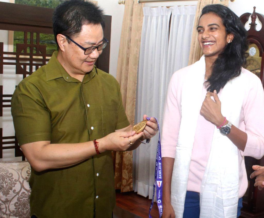 Sports Minister Kiren Rijiju on Tuesday met newly crowned world champion P.V. Sindhu - Kiren Rijiju