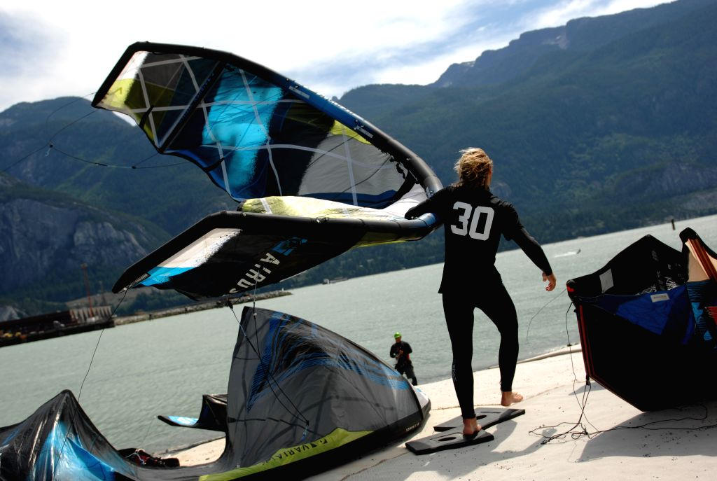 An athlete prepares before the first day of the 2014 Kite Clash Canadian Open Kiteboarding Freestyle Championships in Squamish, BC, Canada, Aug. 1, 2014. World's ...