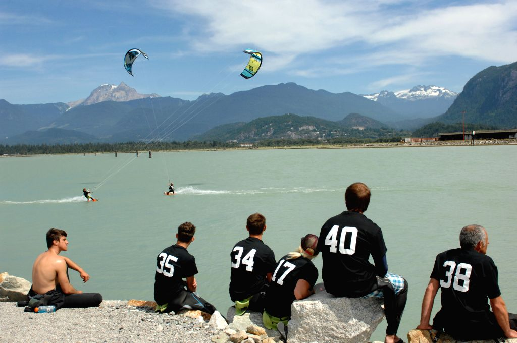 Athletes compete during the first day of the 2014 Kite Clash Canadian Open Kiteboarding Freestyle Championships in Squamish, BC, Canada, Aug. 1, 2014. World's top ..