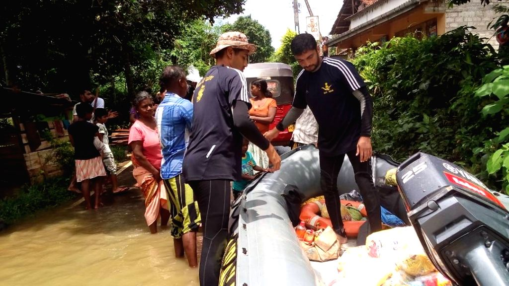 Sri Lanka: Indian Navy personnel carry on relief and rescue operations in flood hit Sri Lanka on May 30, 2017.