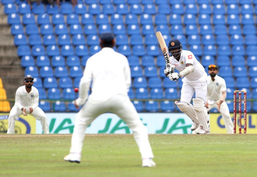 Sri Lanka's Angelo Mathews plays a shot on Day 3 of the third test match between India and Sri Lanka at Pallekele International Cricket Stadium in Pallekele, Sri Lanka on Aug 14, 2017.