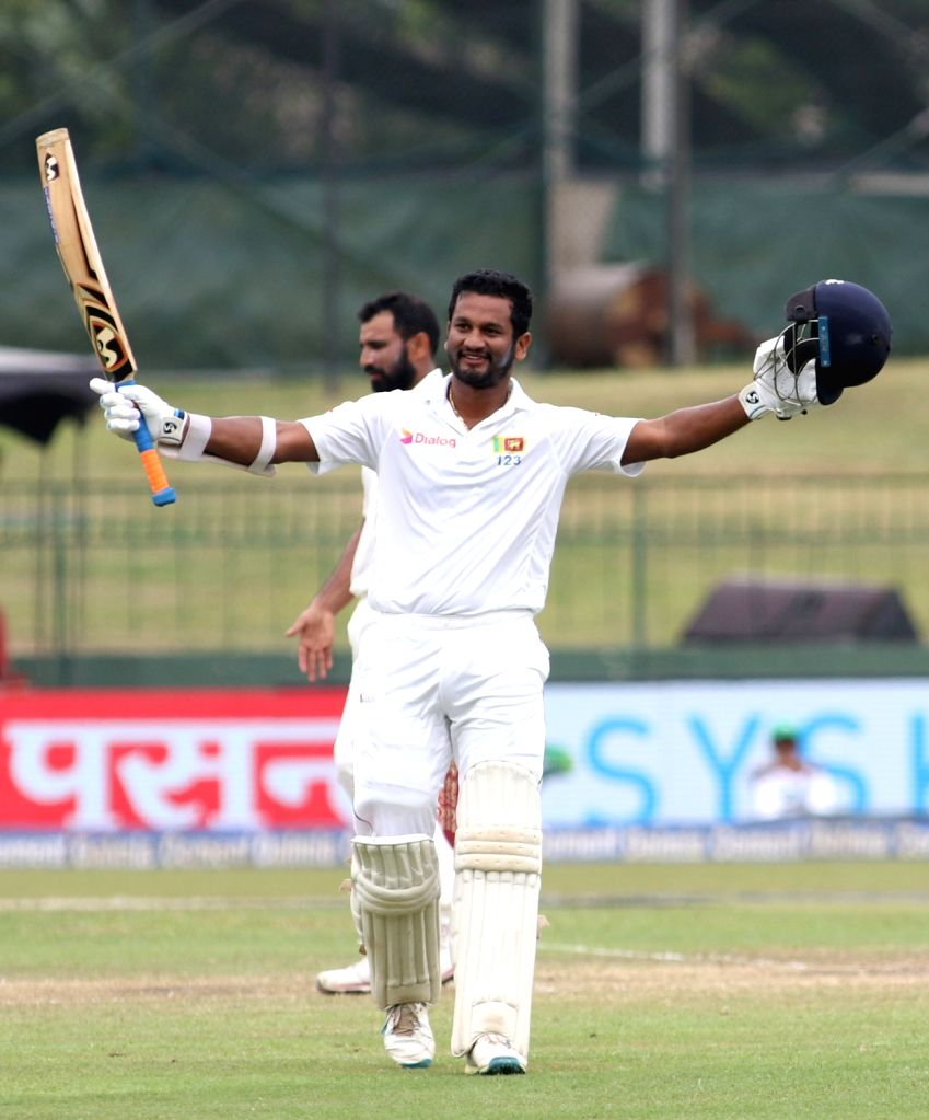 Sri Lanka's Dimuth Karunaratne celebrates his century on Day 4 of the second test match between India and Sri Lanka at Sinhalese Sports Club Ground in Colombo, Sri Lanka on Aug 6, 2017.