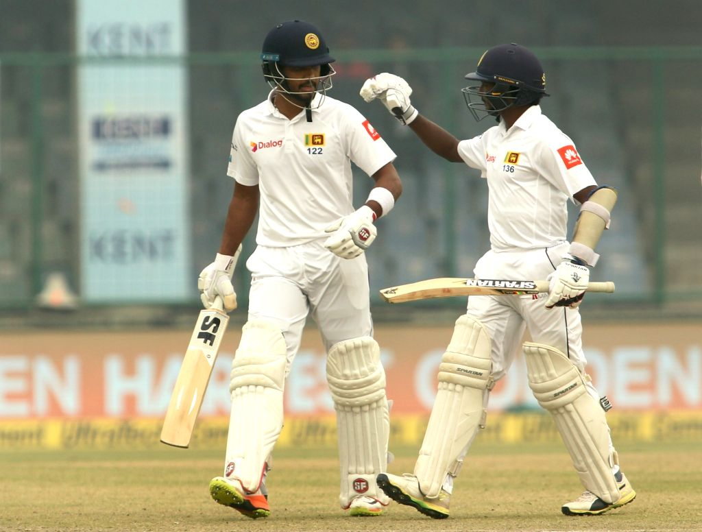 Sri Lanka's Dinesh Chandimal and Lakshan Sandakan during Day 4 of the third test match between India and Sri Lanka at Feroz Shah Kotla Stadium in New Delhi on Dec 5, 2017.
