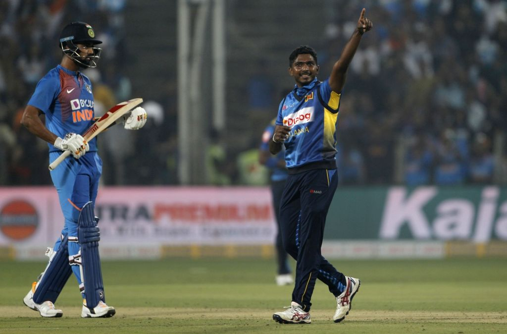 Sri Lanka's Lakshan Sandakan celebrates fall of Shikhar Dhawan's wicket during the 3rd T20I match between India and Sri Lanka at the Maharashtra Cricket Association Stadium in Pune on Jan 10, ...
