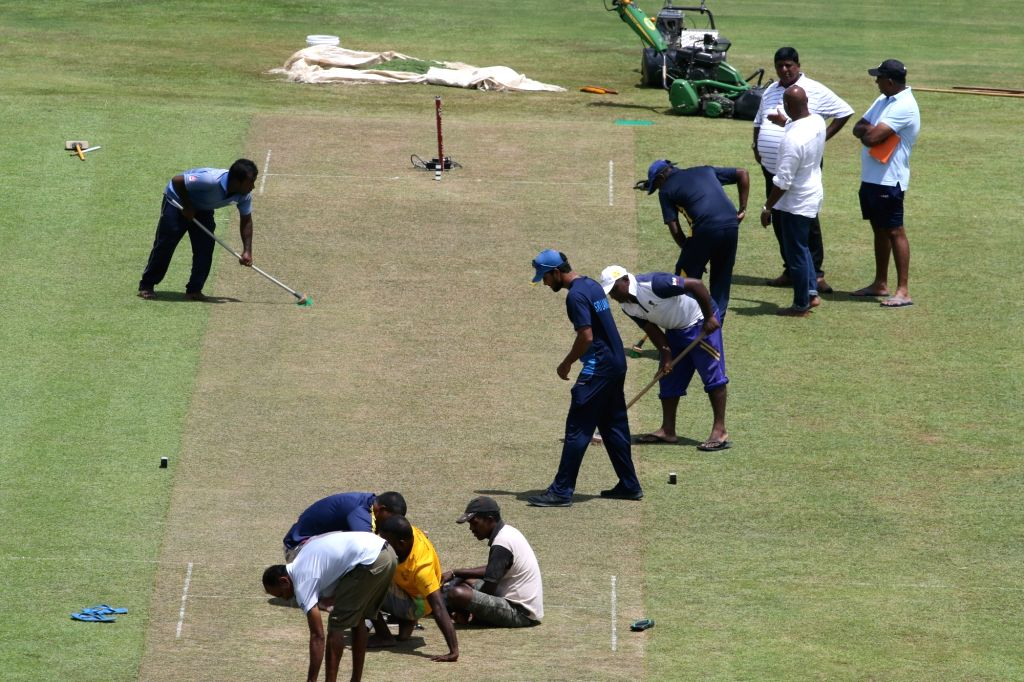 Sri Lanka's test captain Dinesh Chandimal (wearing blue cap), along with chief selector Sanath Jayasuriya and manager cricket Asanka Gurusinha inspects the pitch that will be used for the ... - Dinesh Chandimal