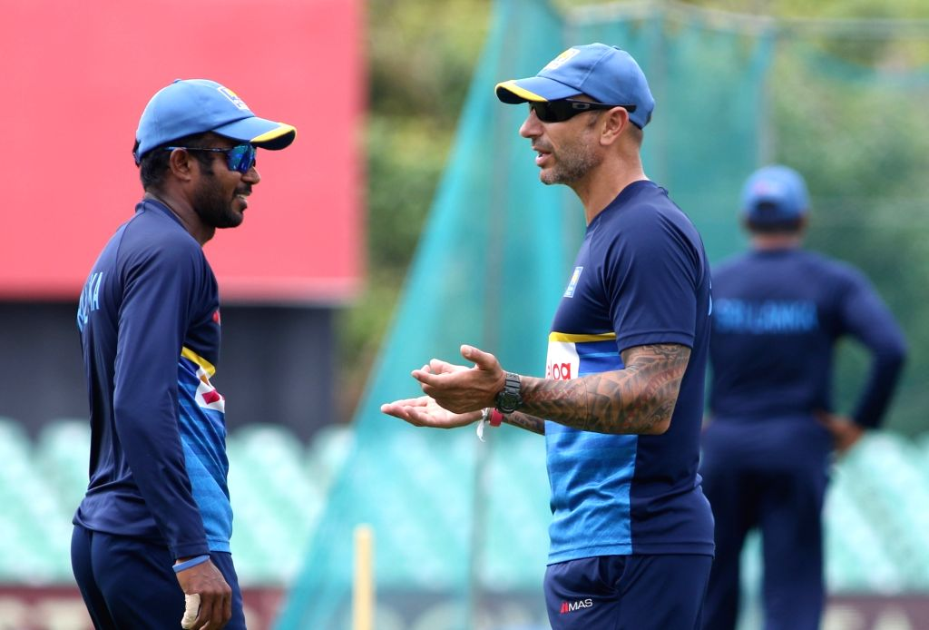Sri Lankan captain Upul Tharanga interacts with interim head coach Nic Pothas during a practice session ahead of the first one-day international cricket match against India in Dambulla, Sri ... - Upul Tharanga