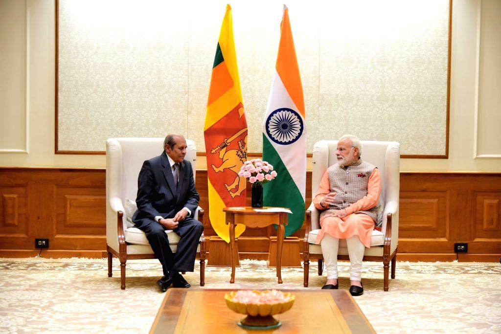 Sri Lankan Foreign Minister Tilak Marapana calls on Prime Minister Narendra Modi in New Delhi on Sept 9, 2017. - Tilak Marapana and Narendra Modi