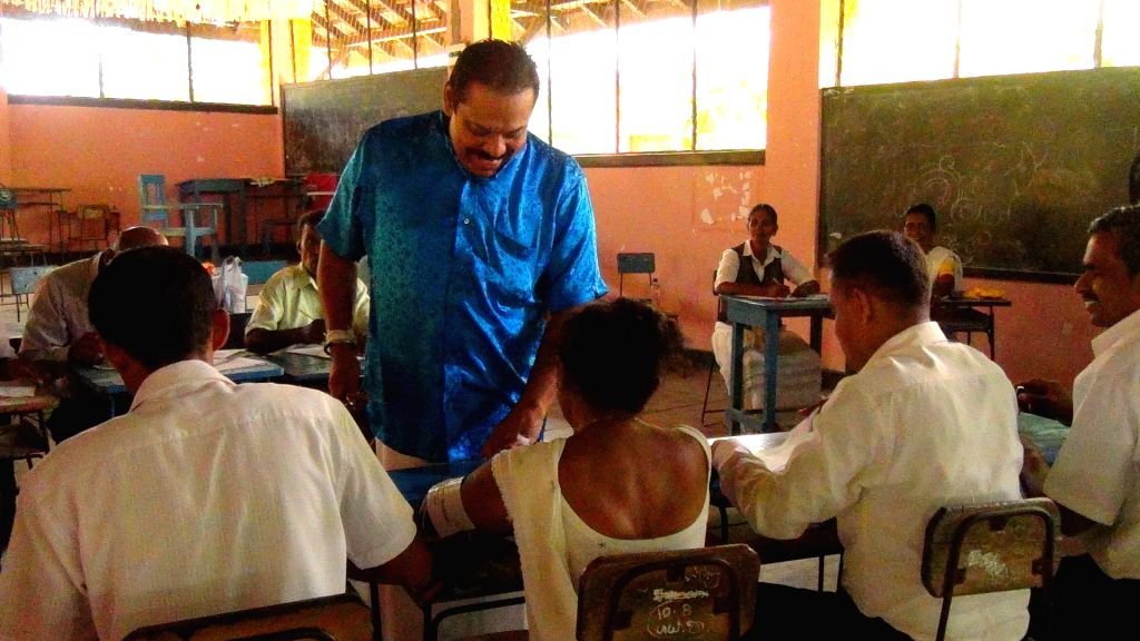 Sri Lankan former president and candidate of the opposition United People's Freedom Alliance (UPFA) Mahinda Rajapakse (C) votes at a polling station in Hambantota, ...