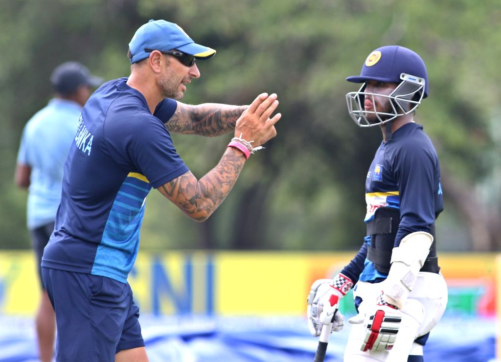 Sri Lankan interim head coach Nic Pothas interacts with Kusal Mendis during a practice session ahead of the first one-day international cricket match against India in Dambulla, Sri Lanka on ...