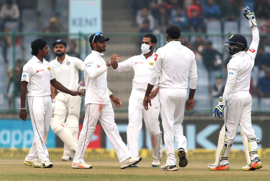 Sri Lankan players celebrate fall of Shikhar Dhawan's wicket on Day 4 of the third test match between India and Sri Lanka at Feroz Shah Kotla Stadium in New Delhi on Dec 5, 2017.