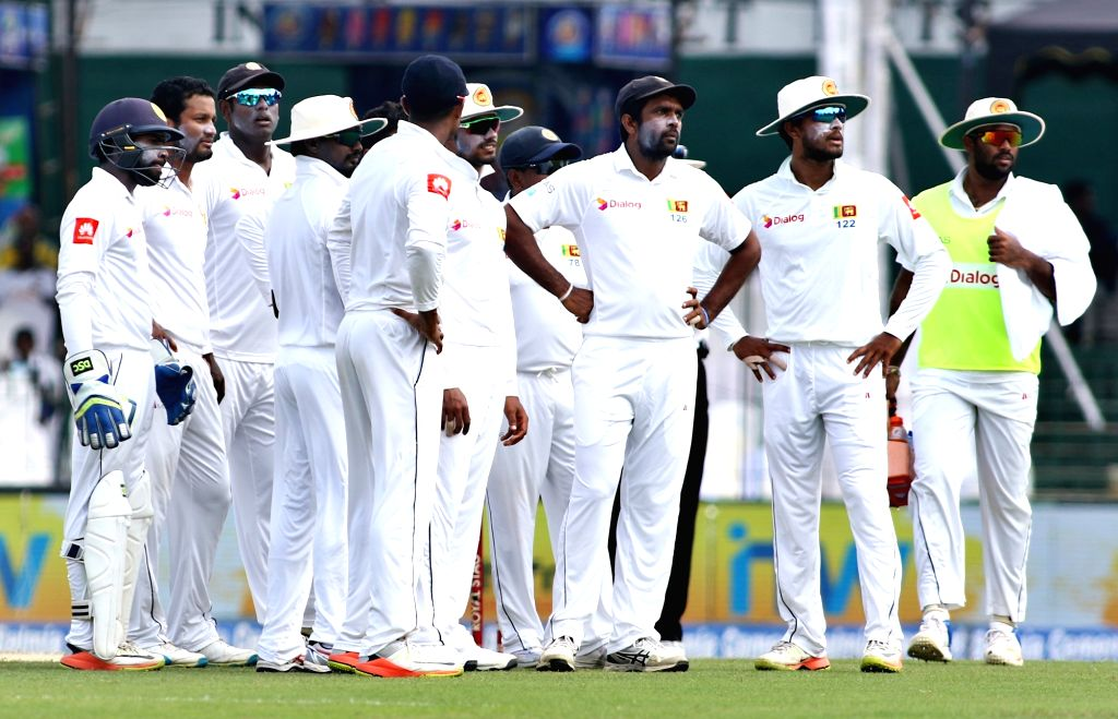 Sri Lankan players see a review for the wicket of India's Cheteshwar Pujara during the second cricket test match between India and Sri Lanka in Colombo, Sri Lanka, on Aug. 4, 2017.