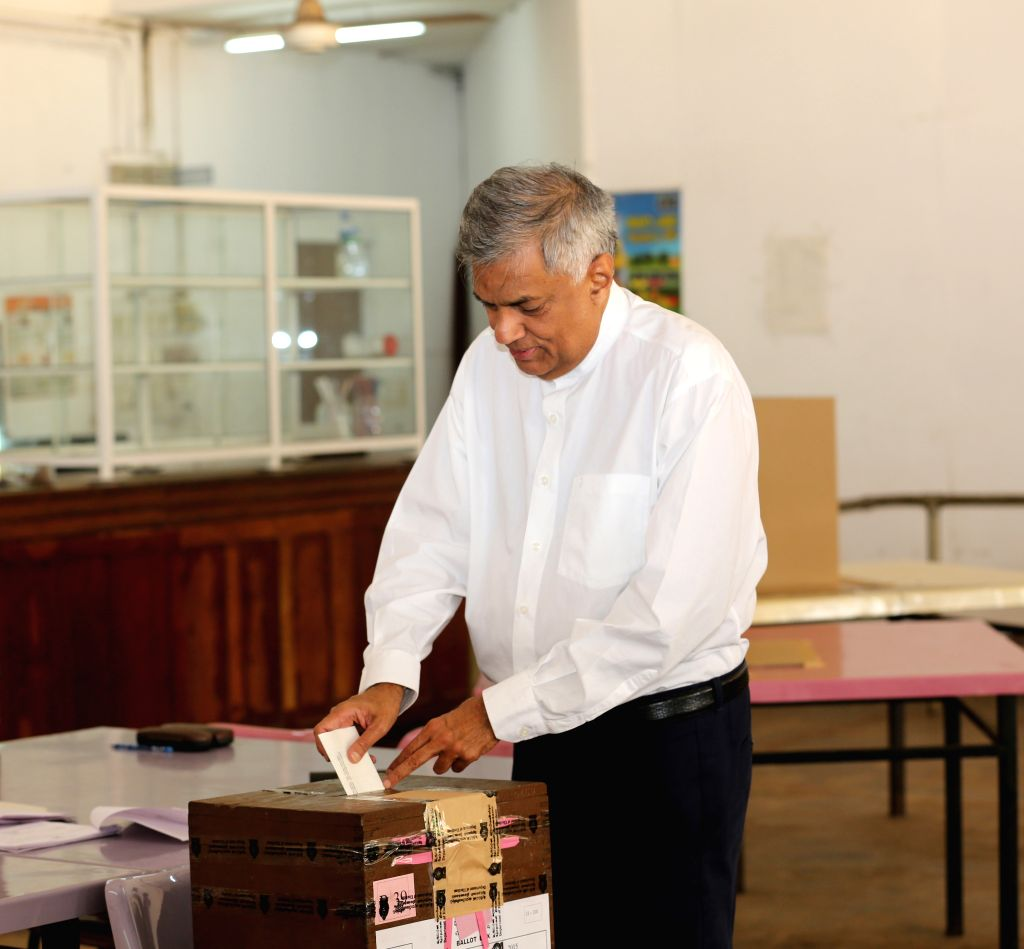Sri Lankan Prime Minister and candidate of the ruling United National Party (UNP) Ranil Wickremesinghe casts his vote at a polling station in Colombo, capital of ...