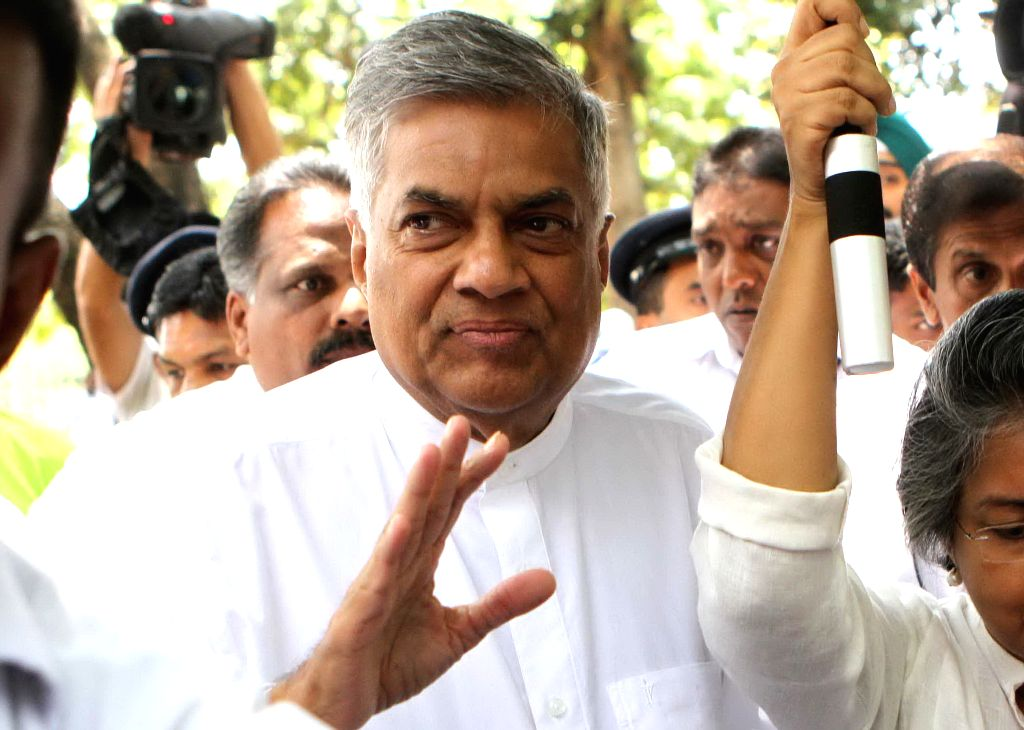 Sri Lankan Prime Minister and candidate of the ruling United National Party (UNP) Ranil Wickremesinghe (C) arrives at a polling station in Colombo, capital of Sri ...