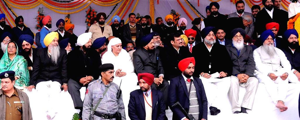 Sri Muktsar Sahib: Punjab Chief Minister Parkash Singh Badal and Punjab Deputy Chief Minister Sukhbir Singh Badal and others during a Shiromani Akali Dal conference in Sri Muktsar Sahib of Punjab on . - Parkash Singh Badal and Sukhbir Singh Badal